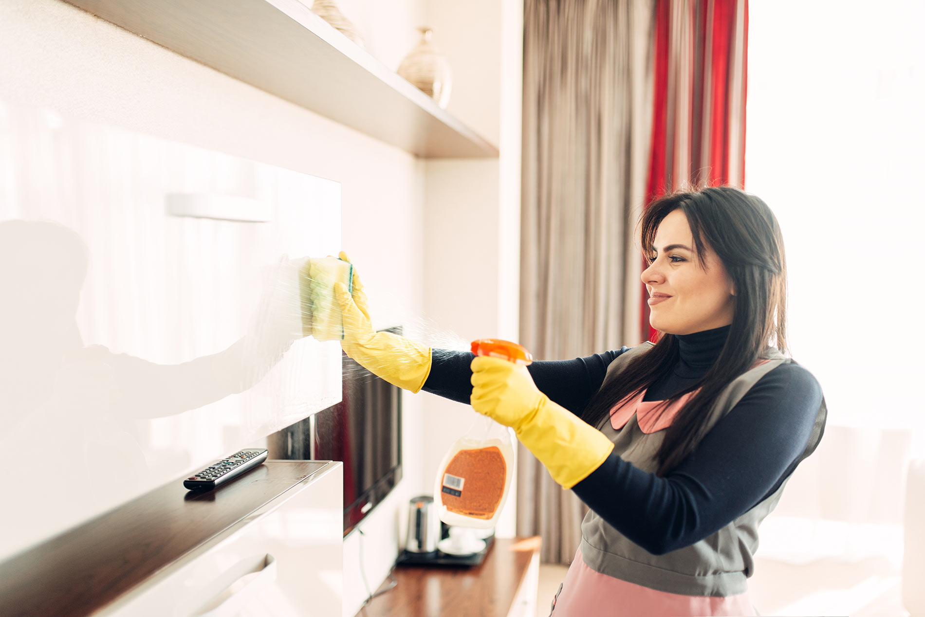 housemaid-cleans-furniture-with-a-cleaning-spray-H2NMVYK.jpg