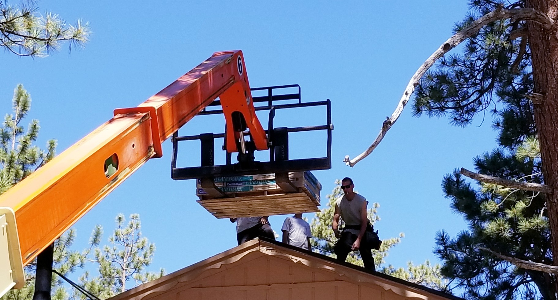 roofing-a-professional-roofer-stands.jpg