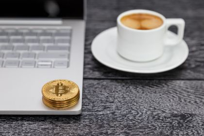 a-stack-of-gold-coins-with-a-bitcoin-symbol-lie-on-the-laptop-keyboard.jpg