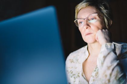 middle-aged-woman-working-on-laptop-P75AVA5.jpg