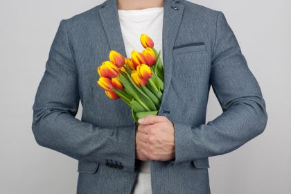 romantic-man-in-a-jacket-holding-a-bouquet-of-tulips-flowers-nominated_t20_Ozl7vp.jpg